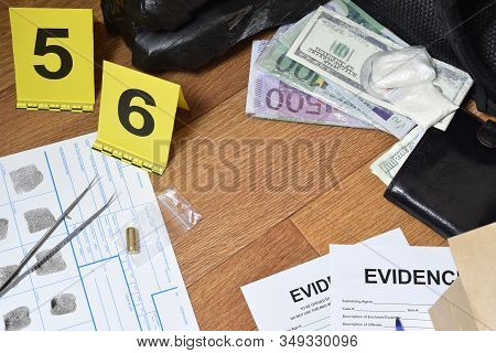 Evidence Chain Of Custody Labels And Brown Paper Bag With Fingerprints Applicant Card Lies Against B