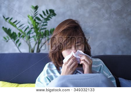 Asian Women Are Ill With Fever And Runny Nose.
