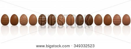 Chocolate Easter Eggs. Lined Up With Different Chocolate And Patterns, Dark, Light And Milk Chocolat