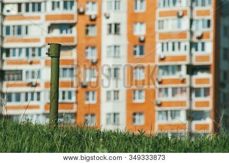 Modern New, Multi-family Residential Building With Green Grass In The Foreground. The Concept Of New