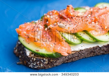 Sandwich With Smoked Salmon And Cucumber. Concept For Healthy Nutrition.