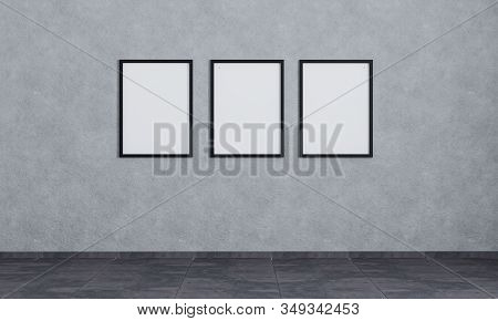 Three Empty Picture Frames On Grey Concrete Wall With Dark Tiling. Poster Frames Mockup. Empty Room