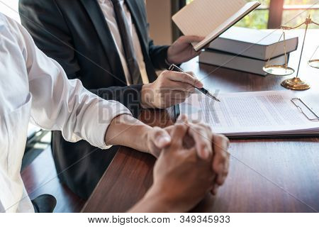 Male Notary Lawyer Or Judge Consult Or Discussing Contract Papers With Businessman Client In Office,