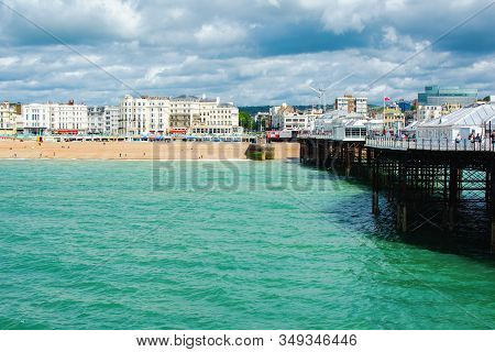 Brighton, East Sussex, Uk - June 21 : View Of Brighton Town Seafront, Houses And Beach From The Pier