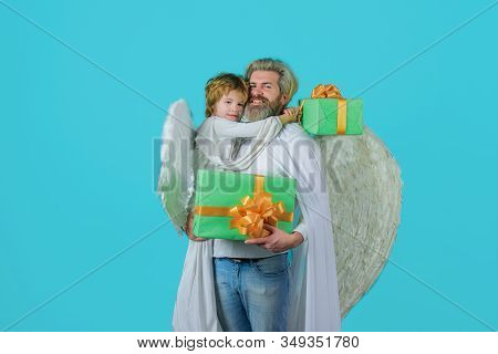 Father's Day. Gift Box. Little Cupid Boy Gives Father Gift. Happy Father In Angel Costume With Littl