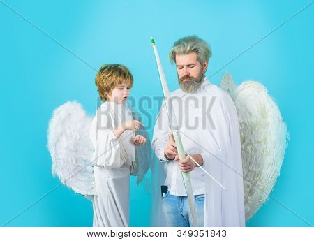 Little Cupid Boy And Father With Bow And Arrow. Happy Father In Angel Costume With Little Son Angel.