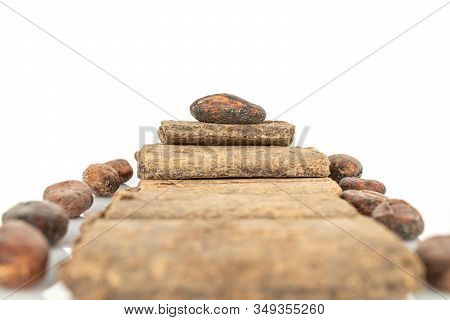Lot Of Fresh Brown Cocoa Beans With Cocoa Butter Bars Isolated On White Background