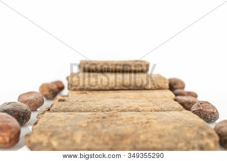 Lot Of Fresh Brown Cocoa Beans With Cocoa Butter Bars Line Isolated On White Background