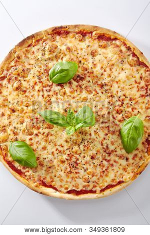 Traditional italian margarita pizza with tomatoes and mozzarella on a metal tray isolated. Hot tasty margherita pizza with melted cheese, delicious flatbread cutout, tasty pizzeria fast food topview