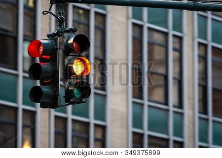 Traffic Light With Red Light Above Manhatan Street Among Many Skyscrapers, New York, Usa