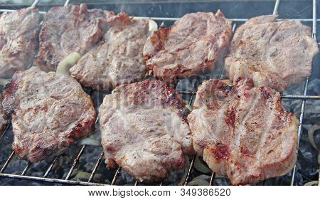 Barbecue Lunch Outdoors. Process Of Cooking Meaty Food On Fire. Steak Grilling On Fire. Process Of C
