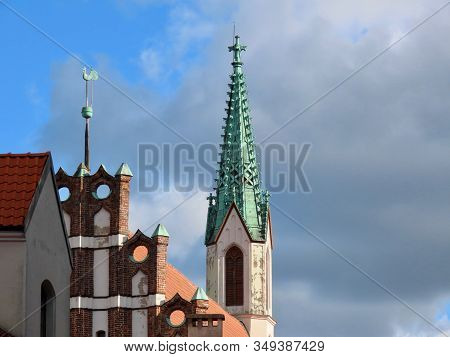 Tower Of St Jan - The Oldest Church In Riga, Latvia, - Green Copper Spire And Facade With Rooster Ov
