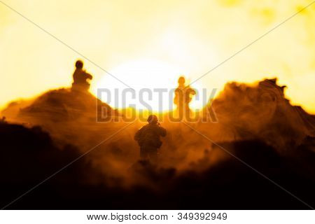 Selective Focus Of Toy Warriors On Battleground With Sunset At Background, Battle Scene