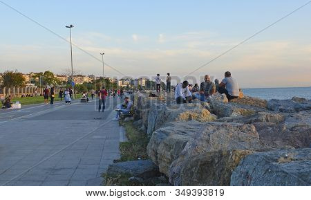 Istanbul, Turkey - September 16th 2019. People Relax In The Late Afternoon Sun On The Waterfront In