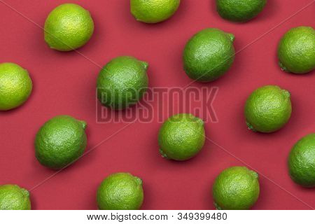Summer Pattern With Limes. Food Pattern With Limes On Red Background. Top View. Summer Concept. Vega