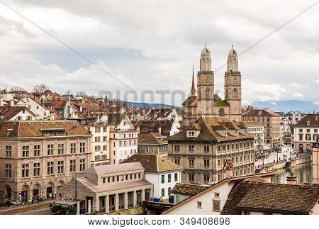 Beautiful Panoramic View Of Historic City Center Of Zurich With Famous Grossmunster Church, Helmhaus
