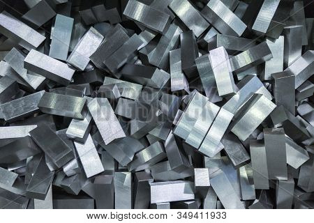 A Pile Of Shiny Faceted Steel Blocks - Full Frame Close-up With Selective Focus