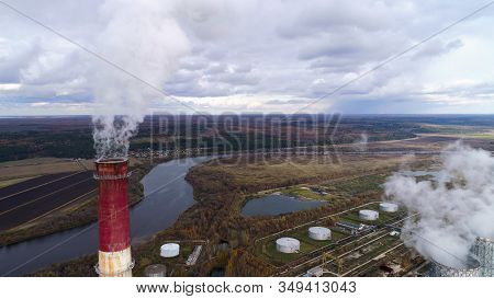 State District Power Station Aerial View. High Factory Chimney, A Powerful Stream Of Steam Comes Fro