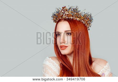 Beautiful Girl In A Golden Crown On Grey Background, Looking To The Side Hopeful With Daydreaming Lo