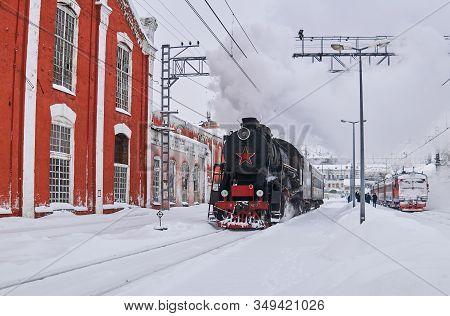 Perm, Russia - February 01, 2020: Vintage Steam Locomotive Passing Through Perm-1 Station