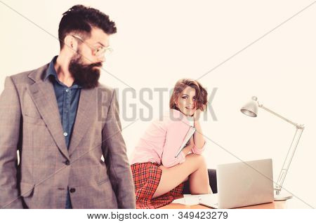 Man Bearded Boss Stand In Front Of Sexy Girl Working Laptop. Office Manager Or Secretary. Sexy Lady