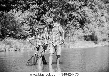 Fisherman Family. Hobby Sport Activity. Summer Weekend. Peaceful Activity. Father And Son Fishing. N