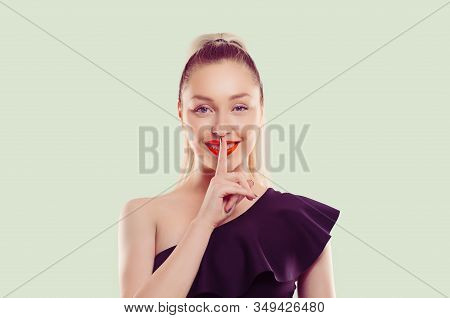 Hush. Woman Smiling Asking For Silence Or Secrecy With Finger On Lips Shh Hand Gesture Light Green B