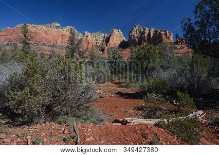Sunny Panoramic Vista On Scenic Red Rock Formations, From A Trail Head In Rural Sedona, Northern Ari