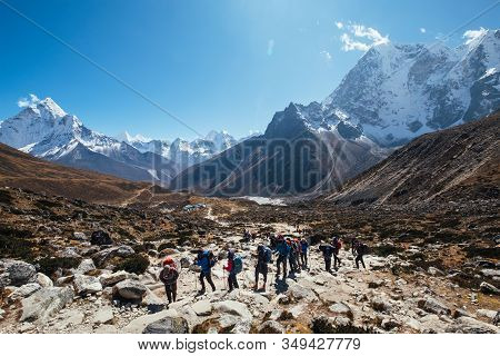 Large Expedition Members Grouon Everest Base Camp Trekking Route Near Dughla 4620m. Backpackers Usin