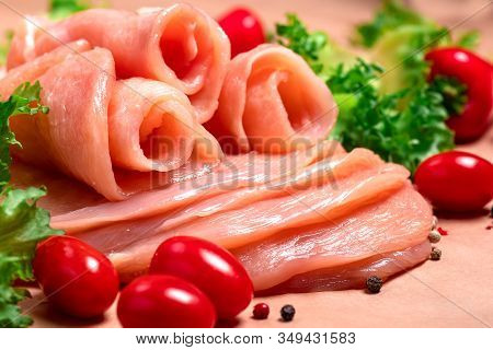 Raw sliced chicken meat close-up. Sotilissimo. Delicious dietary meat. Cooking,food of meat and fillets.Close-up view of raw, fresh, choped and sliced chicken meat.Sottilissime.