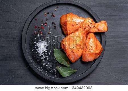 Raw Chicken Legs In A Marinade With Spices On A Black Plate, Marinated Chicken Legs For Bbq.raw Meat