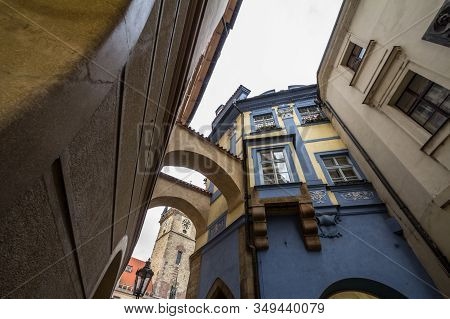 Narrow Street Of The Old Town Of Prague, Called Stare Mesto, With Medieval Buildings And The Clockto