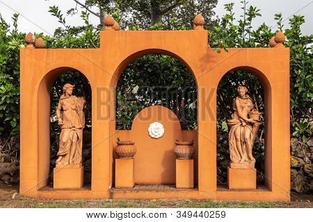 Waimea, Hawaii, Usa. - January 15, 2020: Parker Ranch Headquarters. Orange Statue In Garden Showing