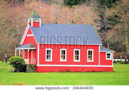 January 15, 2020 In Orick, Ca:  Little Red Schoolhouse Which Was Opened In 1893 Taken On A Lush Fiel
