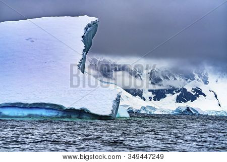 Floating Blue Iceberg Floating Sea Water Snow Mountains Glaciers Charlotte Bay Antarctic Peninsula A