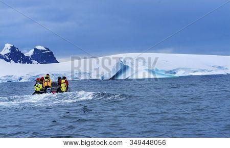 Charlotte Bay, Antarctica - December 26, 2019 Tourists Rubber Boat Zodiac Glaciers Snow Mountains Ch