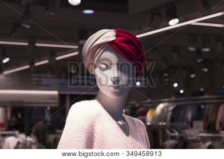 Girl Woman Female Mannequin In A Shop Window. On The Head Is A Turban, Shawl, Hat, On The Body Is Dr