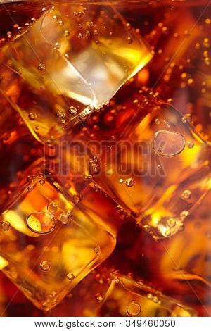 cola with ice cubes, macro