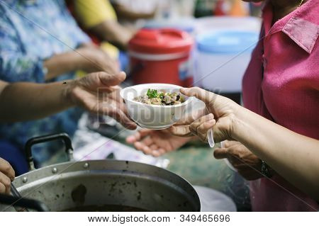 The Concept Of Social Sharing : Poor People Receiving Food From Donations : Homeless People Are Help