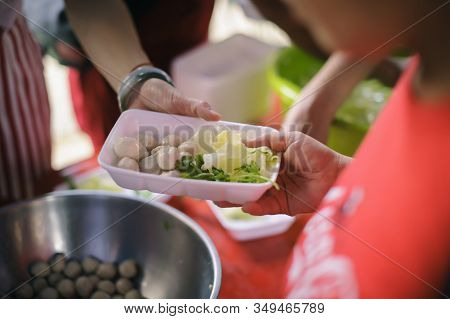 Hand Offered To Donate Food From A Rich Man Share : The Concept Of Social Sharing : Poor People Rece