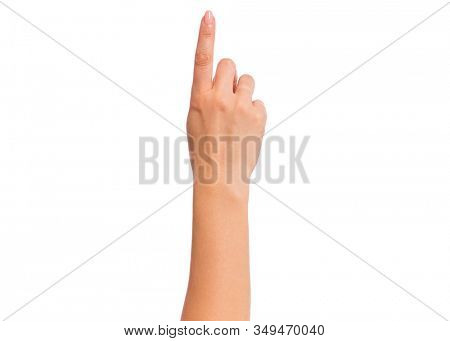 Female hand pointing something, isolated on white background. Beautiful hand close-up of woman with copy space. Finger pointing way.