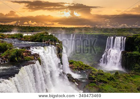 Beautiful Sunset At Iguazu Falls. One Of The New Seven Wonders Of Nature. Traveling South America