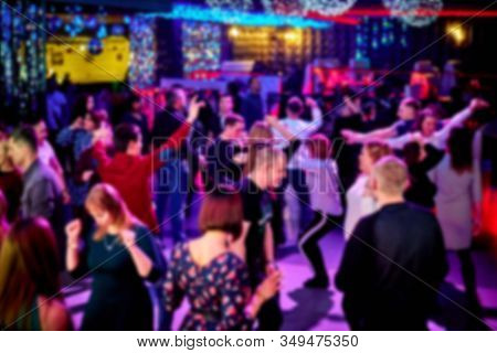 People Dance On The Dance Floor In A Nightclub, A Lot Of People. Bright Strobe Lights. There Is No F