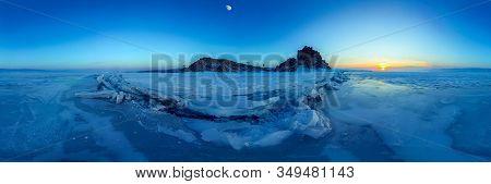 Big Cracks In The Ice Of Lake Baikal At The Shaman Rock On Olkhon Island. Cylindrical Panorama 360