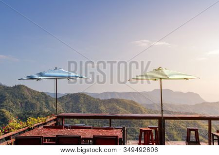 Top View Of Green Hills And Rest And Viewpoint Umbrella Fence At Wat Phra That Pha Son Kaew Temple,