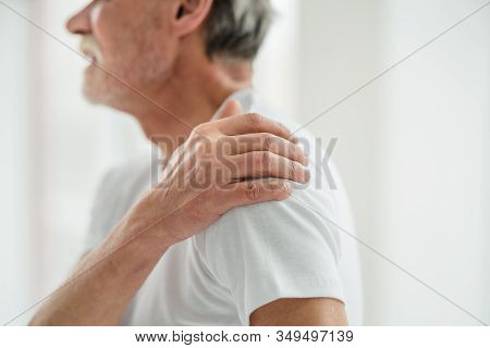 Senior Man Suffering From Pain In Shoulder.take Care Of Your Health.