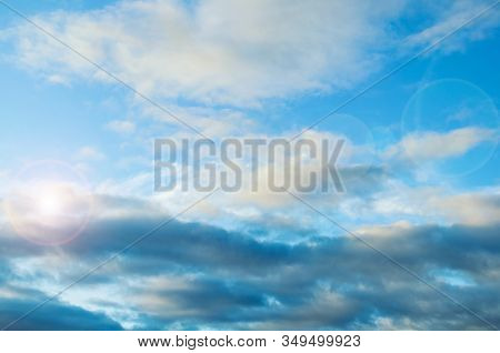 Sky background. Picturesque colorful clouds lit by sunlight. Vast sky landscape panoramic scene - colorful sky view in bright tones