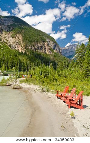 Picnic bench (chair) on the beach of the river in Canada.