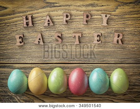 Happy Easter, Easter Eggs On A Wooden Background, Rustic Style. Quail Egg. The View From The Top.