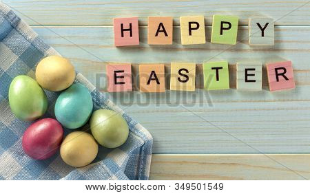 Happy Easter, Easter Eggs On A Wooden Blue Background, Rustic Style. Wooden Colored Letters. Ready C